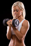 Young sexy woman dumbbells exercises Royalty Free Stock Photography