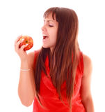 Young sexy woman eating apple Royalty Free Stock Image