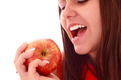 Young sexy woman eating apple Royalty Free Stock Photos