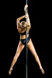 Young sexy woman exercise pole dance Royalty Free Stock Photos