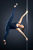 Young sexy woman exercise pole dance Royalty Free Stock Photography