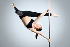 Young sexy woman exercise pole dance Stock Image