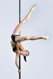 Young sexy woman exercise pole dance Royalty Free Stock Image