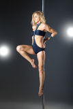 Young sexy woman exercise pole dance Stock Images