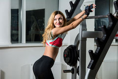 Young sexy woman in the fitness room Stock Photo
