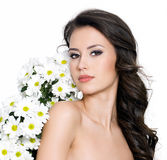 Young sexy woman with flowers Stock Image