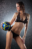 Young sexy woman football player Stock Photo