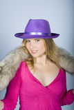 Young sexy woman with fur and hat. Gray background Royalty Free Stock Image