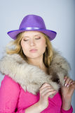 Young woman with fur and hat Royalty Free Stock Photos