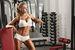 Young sexy woman in the gym. Young sexy woman dressed in white clothes in the gym Stock Images