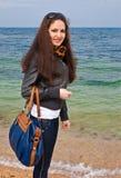 Young sexy woman with handbag. Royalty Free Stock Photos