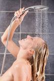 Young sexy woman having a shower Royalty Free Stock Image
