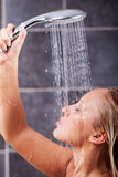 Young sexy woman having a shower Stock Photos