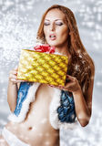 Young sexy woman holding christmas gift Royalty Free Stock Photo