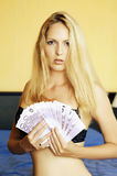 Young sexy woman holding euro cash Royalty Free Stock Photos