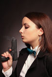 Young and sexy woman holding a gun Royalty Free Stock Image