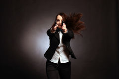 Young and sexy woman holding a gun Royalty Free Stock Photo