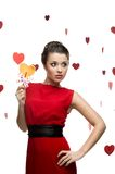 Young sexy woman holding lollipop Royalty Free Stock Images
