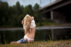 Young woman in jeans Stock Photos