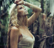Young woman in jungle Stock Image