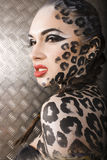Young  sexy woman with leopard make up Royalty Free Stock Photos