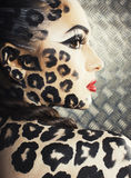Young sexy woman with leopard make up all over body, cat bodyart Stock Image