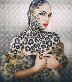 Young sexy woman with leopard make up all over Stock Images