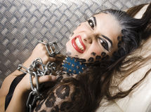 Young woman with leopard make up all over body, cat bodyart closeup, depression halloween. Young woman with leopard make up all over body, cat print bodyart royalty free stock photography