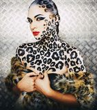 Young sexy woman with leopard make up all over body, cat bodyart closeup, depression. Halloween Royalty Free Stock Images