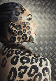 Young sexy woman with leopard make up all over body, cat bodyart closeup sensual Royalty Free Stock Image
