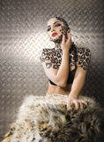 Young woman with leopard make up all over body, cat bodyart closeup sensual. Young woman with leopard make up all over body, cat bodyart print closeup sensual stock photo