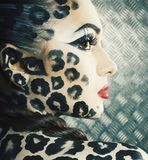 Young woman with leopard make up all over body, cat bodyart closeup. Creative stock images