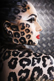 Young sexy woman with leopard make up all over body, cat bodyart, halloween look Royalty Free Stock Photos