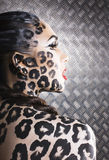 Young sexy woman with leopard make up all over body, cat bodyart, halloween look Stock Images