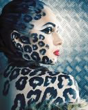 Young sexy woman with leopard make up all over body, cat bodyart print close up stock image