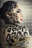 Young woman with leopard make up all over. Body, cat bodyart print closeup stock image