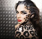 Young sexy woman with leopard make up all over body, cat bodyart. Print closeup sensual Stock Photography