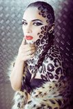 Young sexy woman with leopard make up all over body, cat bodyart. Print closeup sensual Stock Photos
