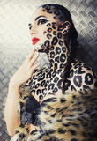 Young woman with leopard make up all over body, cat bodyart. Print closeup sensual royalty free stock photography