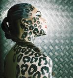 Young woman with leopard make up all over body, cat bodyart print closeup. Young woman with leopard make up all over body, cat bodyart print close up stock image