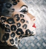Young woman with leopard make up all over body, cat bodyart. Print closeup stock photo