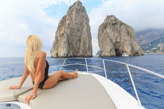 Young sexy woman lies in a boat Stock Images