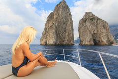 Young sexy woman lies in a yacht Stock Photo