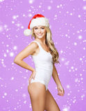 Young and sexy woman in lingerie and a Christmas hat Stock Images