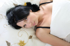 Young sexy woman lying on bed Royalty Free Stock Photo