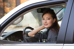 Young sexy woman in the new car Royalty Free Stock Photos