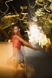 Young sexy woman in New York City, New York at night. Young sexy African-American woman on patio in New York City, New York at night with blurred lights Royalty Free Stock Images