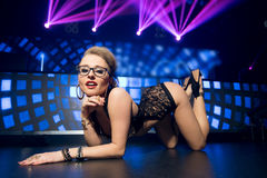 Young sexy woman in night club Royalty Free Stock Photos