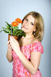 Young sexy woman with orange flowers Royalty Free Stock Image