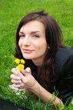 Young sexy woman on the park with flower. Stock Photo